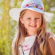 Stock Photo: Smiling girl in the hat