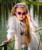 Little girl in sunglasses — Stock Photo