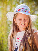 Smiling girl in the hat — Stock Photo