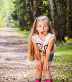 Little frightened girl in the park — Stock Photo