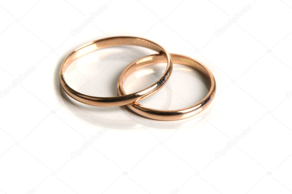 Wedding rings on a white background — Stock Photo #9520035