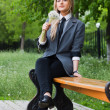 Girl sits in park — Stock Photo