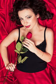 The beautiful woman with a rose — Stock Photo