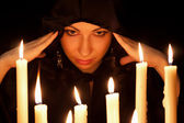 The woman and candles — Stock Photo
