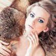 Blond woman with fur — Stock Photo #9973584