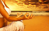 Yoga meditation on the beach — Stock Photo