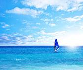 Beach landscape with windsurfer playing — Stock Photo