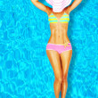 Sexy woman body in the pool — Stockfoto