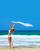 Dancing happy girl on the beach — Stock Photo