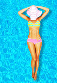 Sexy woman body in the pool — Stok fotoğraf