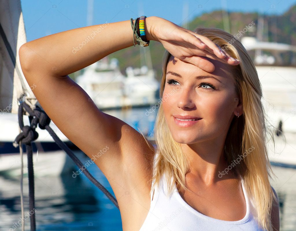 Beautiful teen girl sailing, young woman enjoying summer travel, ...