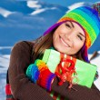 Happy girl with Christmas gift, winter outdoor portrait — Stock Photo #8016440