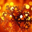 Golden snowflake Christmas tree ornament — Stock Photo