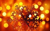 Golden snowflake Christmas tree ornament — Stock Photo