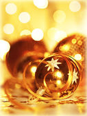 Golden baubles Christmas tree ornament — Stock Photo