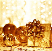 Christmas golden gift decorations — Stock Photo