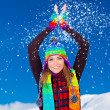 Happy cute girl playing with snow outdoor — Stock Photo