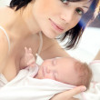 Happy mother with a baby — Stock Photo #8246971