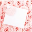 Beautiful roses with gift card & heart — Stock Photo