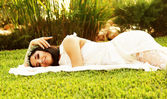 Happy bride on the grass — Stock Photo