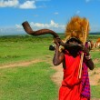 Masai warrior playing traditional horn - Photo