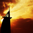 Dramatic sunset with building silhouette — Stock Photo #8299683
