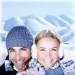 Happy couple playing outdoor at winter mountains — Stock Photo #8502982