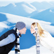 Happy couple playing outdoor at winter mountains — Stock Photo #8502995