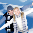 Happy couple playing outdoor at winter mountains — Stock Photo #8503000