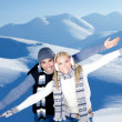 Happy couple playing outdoor at winter mountains — Stock Photo #8601223