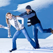 Happy couple having fun in snow — Stock fotografie #8601232