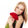 Beautiful female holding red roses bouquet — Stock Photo