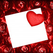 Red roses background with greeting card and heart — 图库照片