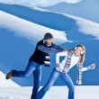 Happy couple having fun in snow — Stock Photo