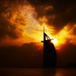 Dramatic sunset with building silhouette — Stock Photo