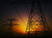 Electricity Pylons over sunset — Stock Photo