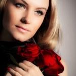 Stylish woman holding roses flower — Stock Photo