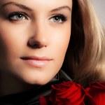 Stylish woman holding roses flower — Stock Photo #8987424