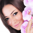 Beautiful female holding orchid flower — Stock Photo