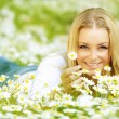 Beautiful girl enjoying daisy field — Stock Photo #9149601