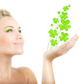 Beautiful woman holding clover leaves — Foto Stock