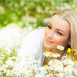 Beautiful female laying on the flower filed — Stock Photo #9314825