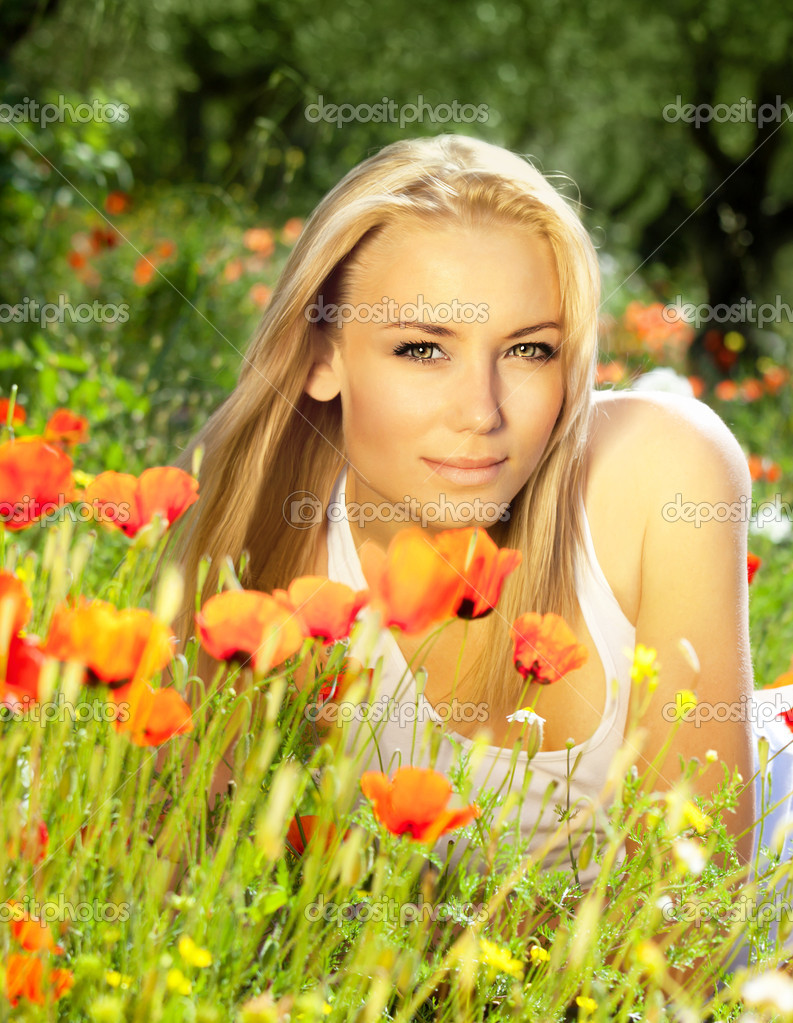 Beautiful female laying on the flower field — Stock Photo ...