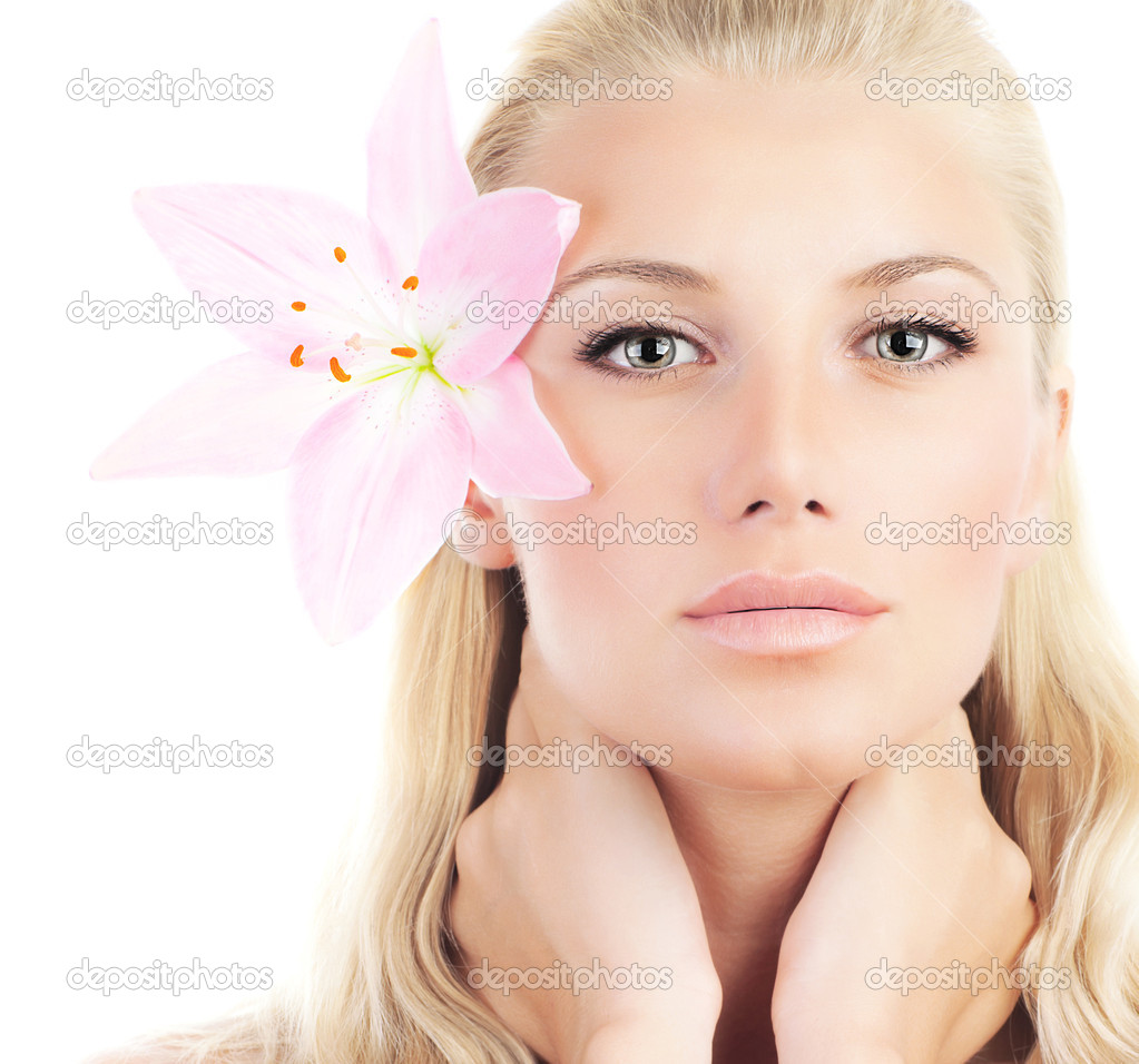Beautiful woman with pink fresh lily flower, sensual female portrait isolated on white background, girl with spring plant, spa skin care and beauty concept  Stock Photo #9314971