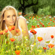 Beautiful female laying on the flower field - Foto de Stock