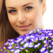 Beautiful female face with flowers — Stock Photo