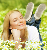 Beautiful female enjoying flower filed — Stock Photo