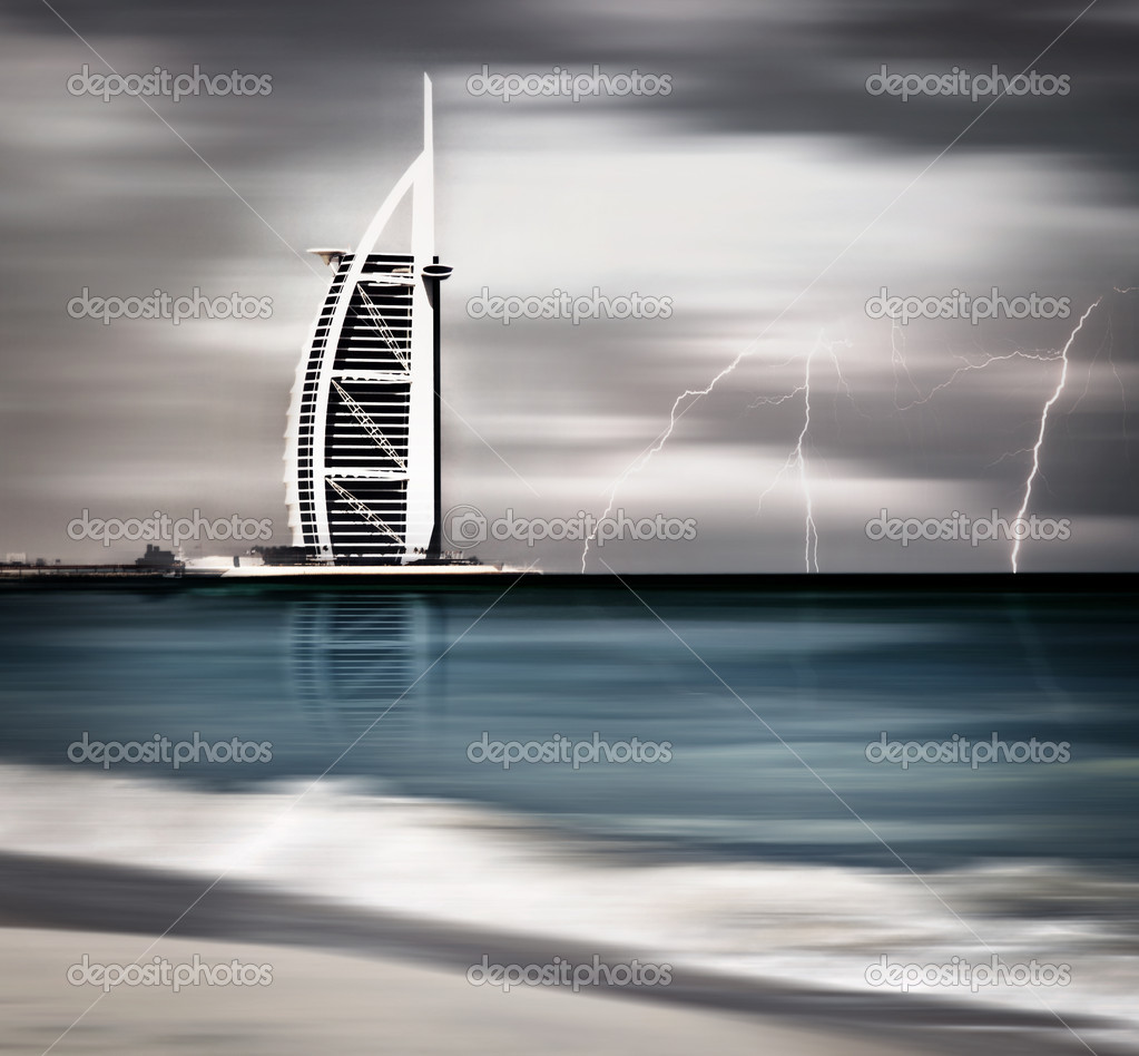 DUBAI, UAE - NOV 21: Burj Al Arab is 321m, second tallest hotel in the world, luxury hotel stands on an artificial island, November 21,2009 Jumeirah beach, Dubai, United Arab Emirates — Photo #9677243