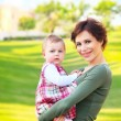 Mother and baby girl outdoor portrait — Stock Photo