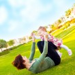 Mother and baby girl playing outdoor — Stock Photo